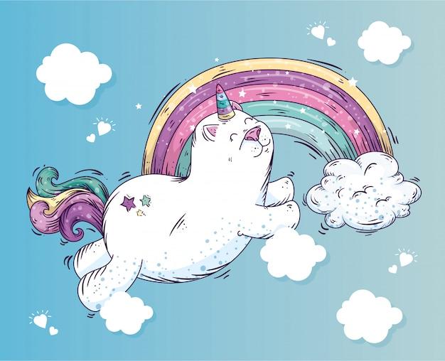 Śliczny kota jednorożec z tęczą i chmurami