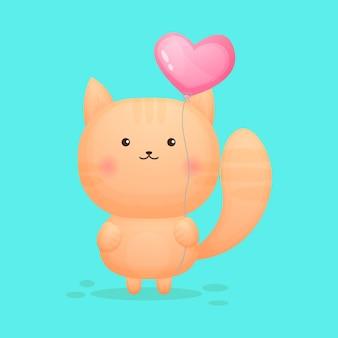 Śliczny kotek trzyma balon w kształcie serca