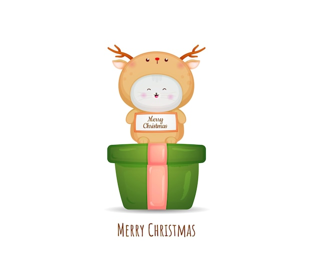 Śliczny kotek w kostiumie jelenia na wesołych kartkach świątecznych premium wektorów