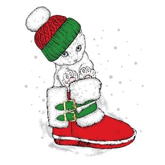 Śliczny kotek w świątecznych zimowych i noworocznych ubraniach