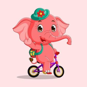 Śliczny kreskówka słoń jedzie bicykl