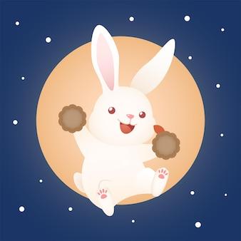 Śliczny króliczek festiwalowy w połowie jesieni trzymający księżycowe ciasto z dużym księżycowym tłem