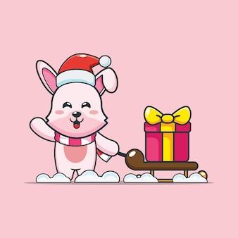 Śliczny króliczek w boże narodzenie niosący prezent śliczna świąteczna ilustracja kreskówka