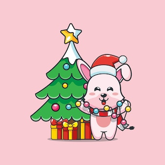 Śliczny króliczek w boże narodzenie trzyma lampkę świąteczną śliczna świąteczna ilustracja kreskówka