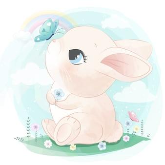Śliczny królik bawić się z motylem