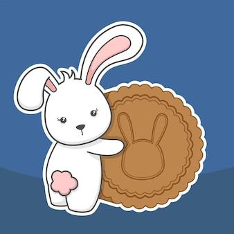 Śliczny królik i księżycowy tort w połowie jesieni