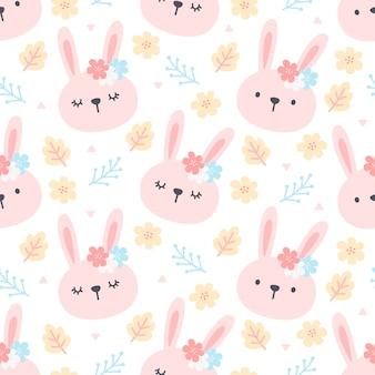 Śliczny królik i kwiecisty bezszwowy deseniowy tło