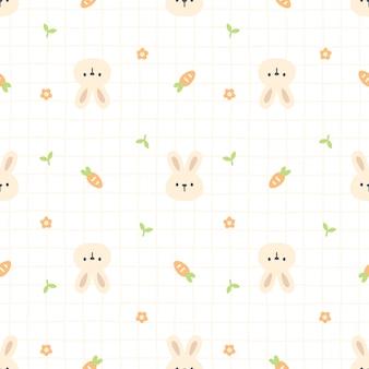 Śliczny królik i marchwiany bezszwowy deseniowy tło
