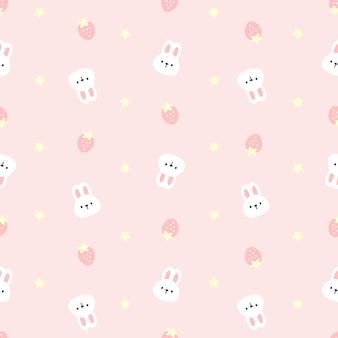 Śliczny królik i truskawkowy bezszwowy deseniowy tło