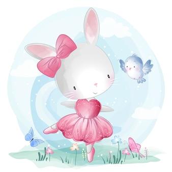 Śliczny królik tanczy z ptakiem