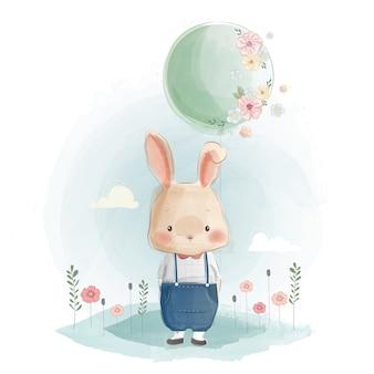 Śliczny królik trzyma balon