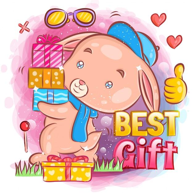 Śliczny królik trzyma prezent urodzinowy na przyjęciu urodzinowym