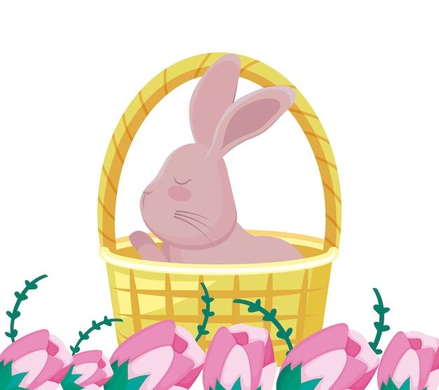 Śliczny królik w koszykowym wiklinowym z kwiatami