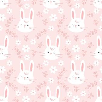 Śliczny królik z kwiatami i liścia bezszwowym deseniowym tłem