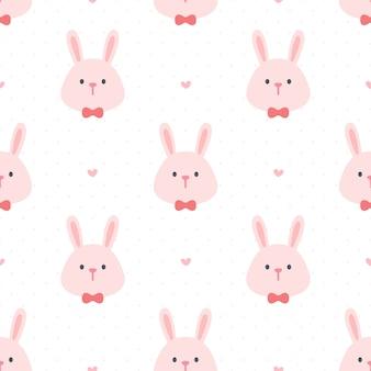 Śliczny królik z muszka bezszwowym deseniowym tłem