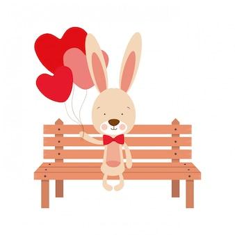 Śliczny królika obsiadanie na parkowym krześle
