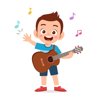 Śliczny mały chłopiec gra na gitarze na koncercie