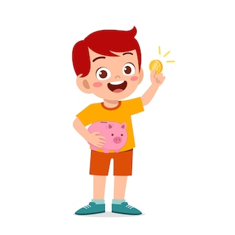 Śliczny mały chłopiec nosi skarbonkę i złotą monetę