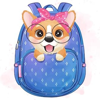 Śliczny mały corgi siedzi wśrodku torby