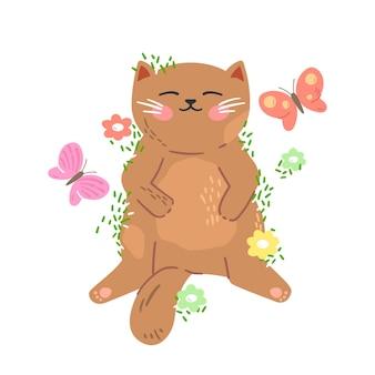 Śliczny mały czerwony kotek śpi na trawie