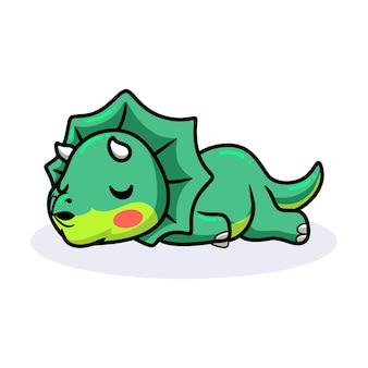 Śliczny mały dinozaur triceratops śpiący kreskówka