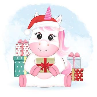 Śliczny mały jednorożec i pudełko prezentowe boże narodzenie ilustracja sezon