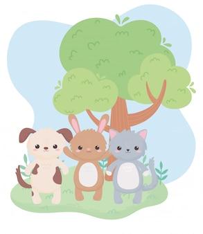 Śliczny mały kot, pies i królik drzewo kreskówka zwierzęta w naturalnym krajobrazie