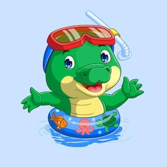 Śliczny mały krokodyl na pływackim basenie