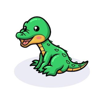 Śliczny mały krokodyl siedzi kreskówka