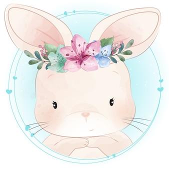 Śliczny mały królik z kwiecistym portretem