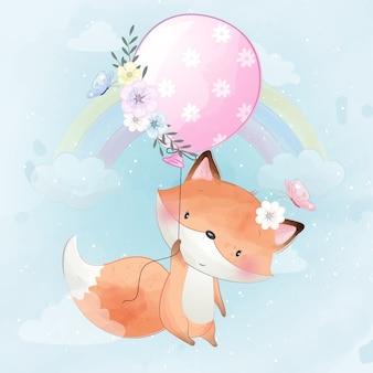 Śliczny mały lisi latanie z balonem