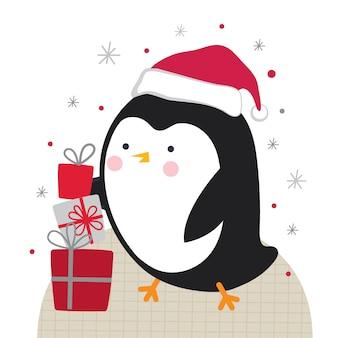 Śliczny mały pingwin z jakimś świątecznym prezentem na białym tle,