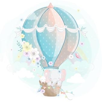 Śliczny mały słoń z królikiem w lotniczym balonie