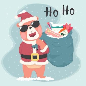 Śliczny niedźwiedź brunatny mikołaj nosi okulary przeciwsłoneczne i trzyma worek prezentów, wesołych kart świątecznych
