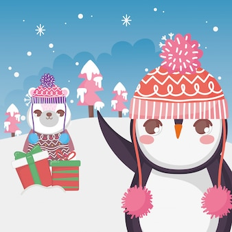 Śliczny niedźwiedź polarny i pingwin z prezenta śniegu krajobrazem wesoło boże narodzenia