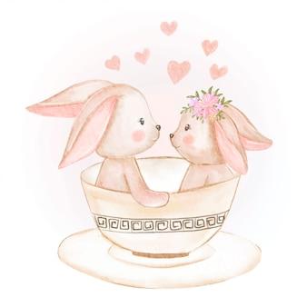 Śliczny para królik w filiżanki akwareli ilustraci