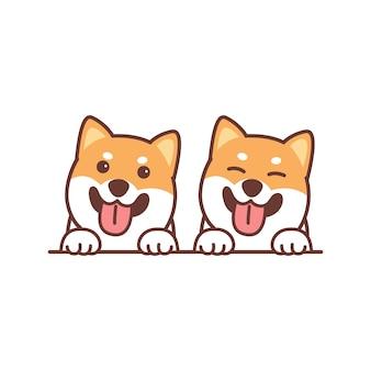 Śliczny pies shiba inu uśmiechający się nad kreskówką na ścianie