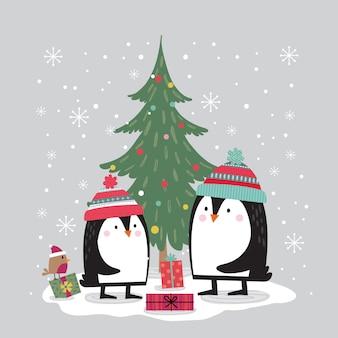 Śliczny pingwin dekoruje choinki