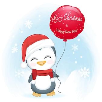 Śliczny pingwin i czerwony balon w zimowej świątecznej ilustracji
