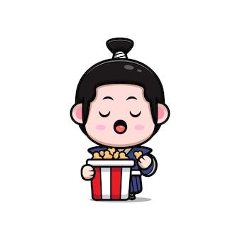 Śliczny samuraj chłopiec jedzący popcorn maskotka ilustracja