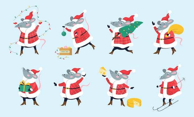 Śliczny świąteczny zestaw szczurów trzymający świąteczne rzeczy.