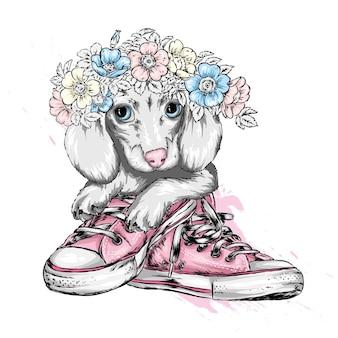 Śliczny szczeniak w wieniec kwiatów.