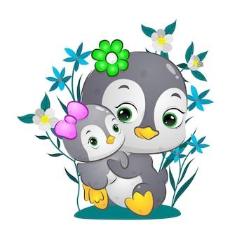 Śliczny szczęśliwy pingwin podnosi dziecko na tle kwiatów ilustracji