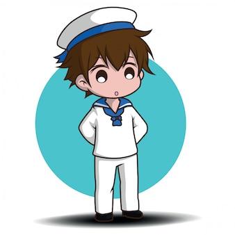 Śliczny uśmiechnięty mały chłopiec charakter jest ubranym żeglarzy.