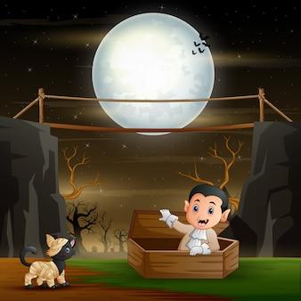 Śliczny wampir i mamusia kot w nocnym krajobrazie