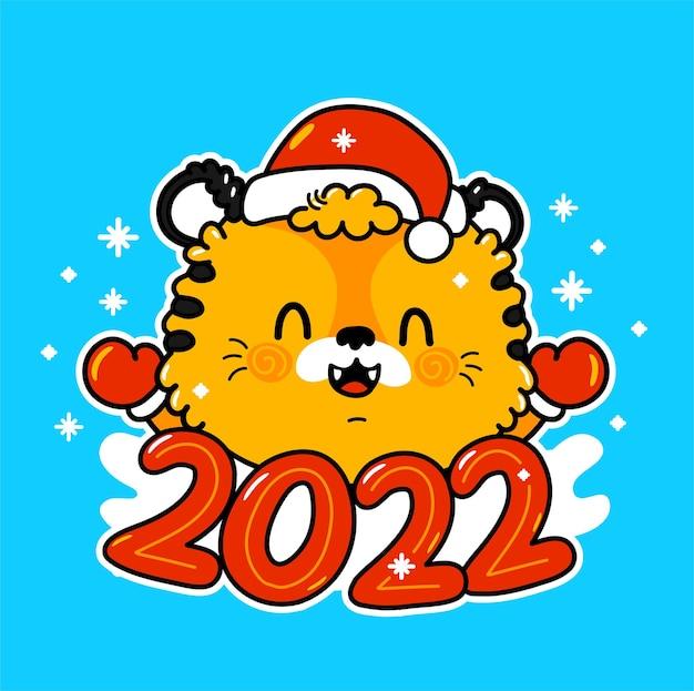 Śliczny zabawny symbol nowego roku 2022 tygrys w postaci świątecznej czapki
