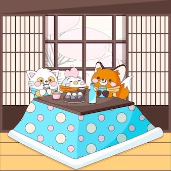 Słodcy przyjaciele zwierząt siedzą wokół stołu kotatsu