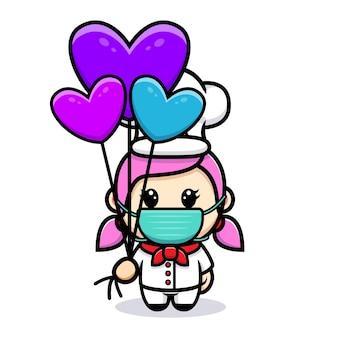 Słodka dziewczyna szefa kuchni z balonem maskotka