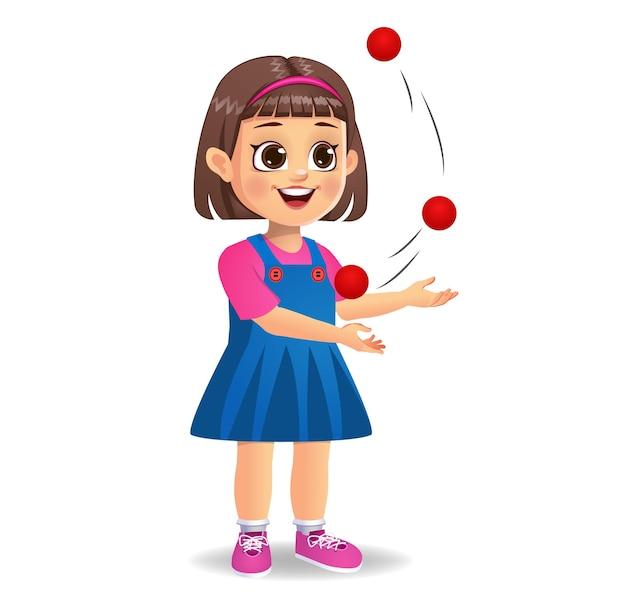 Słodka dziewczynka gra w żonglerkę