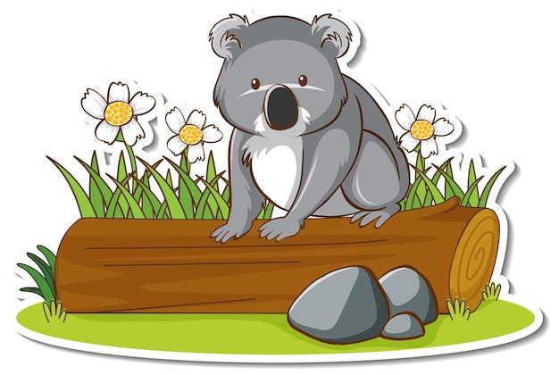 Słodka koala siedząca na naklejce z kłody